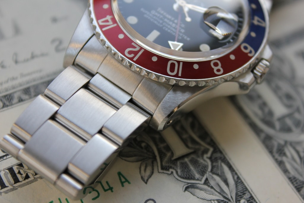 Rolex GMT Reference 1675 chamfer Bring a Loupe: A Diverse Selection Ranging From A $500 Takano To A $25,000 Rolex GMT Retailed By Tiffany Bring a Loupe: A Diverse Selection Ranging From A $500 Takano To A $25,000 Rolex GMT Retailed By Tiffany Rolex 1675 side